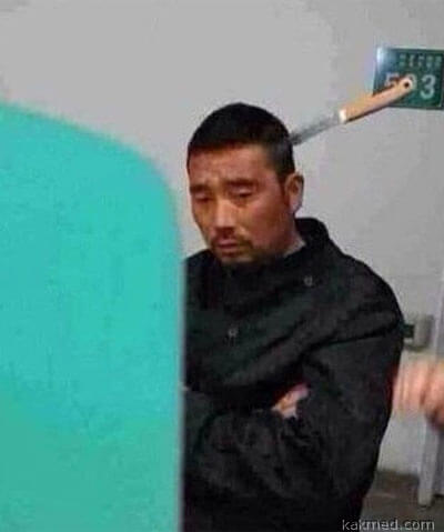 Китаец с ножом в голове